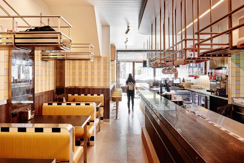 طراحی رستوران با تم پاستلی زرد و بنفش آبی
